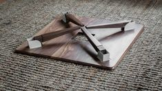 Foldable legs on a walnut coffee table for easy assembly and portability.