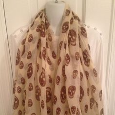 """Skull scarf NWOT Beige scarf with brown skulls. About 70"""" x 40"""". 100% viscose. Accessories Scarves & Wraps"""