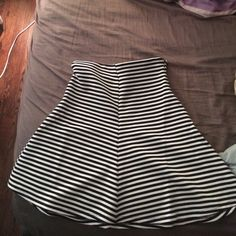 Forever 21 skirt - knee long white/black stripes Forever 21 knee length skirt, black/white stripes. Never been worn, still has original tags. Waist band is elastic and stretchy as shown in last picture. Forever 21 Skirts