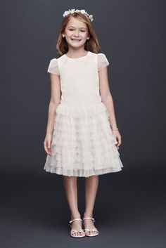 A fun and frilly choice for a lighthearted little one, this flower girl dress is crafted with tiny tulle ruffles and sheer cap sleeves.   Polyester  Back zipper; fully lined  Dry clean  Imported