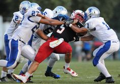 Lebanon's Mark Pyles is sacked by a gaggle of Cedar Crest Falcons during the first half of the 41st annual Cedar Bowl on August 31, 2012. LEBANON DAILY NEWS - JEREMY LONG