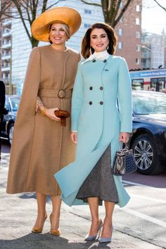 Dutch Queen Maxima cut a stylish figure as she wore a warm belted camel cape, matched with a wide-brimmed hat and coordinated heels, While Jordanian Queen Rania sported a light teal blue woolen coat with side button detail and a whisp of a chiffon scarf at the neck and a pair of blue heels, posed for photographers as they toured the Gemeentemuseum in The Hague.