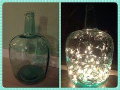 Before - After. Flessen te koop bij Action, kerstverlichting voor binnen, momenteel vrijwel overal te koop. Leuk met verschillende soorten vazen en flessen. Probeer ook eens een rode, oranje of zelfs (donker)grijze vaas of fles, je zult verrast zijn door het mooie effect van de lampjes!