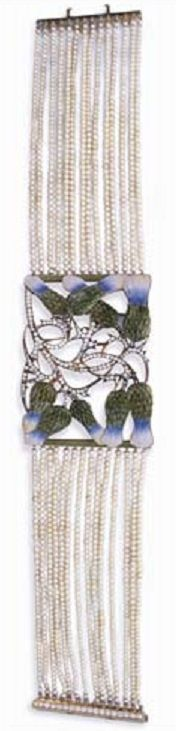 AN ART NOUVEAU DIAMOND, ENAMEL AND SEED PEARL DOG COLLAR, BY RENÉ LALIQUE. The central section designed as a convex openwork panel depicting nine olive green, blue, pink and yellow enamel thistle flowers with pavé-set diamond stems, bordered by olive green enamel bars, to the fourteen-row seed pearl band with a diamond line clasp, the reverse of panel engraved with a gold thistle pattern, mounted in gold, circa 1900, 12¼ ins. Signed Lalique for René Lalique.Rene Lalique Ideas, Nature and Art…
