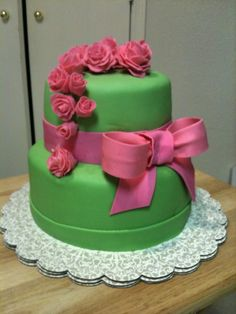 Cute pink and green cake with flowers and a bow. I wannna learn to do this!