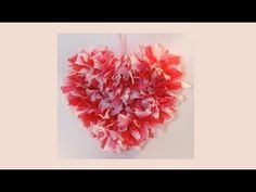 Make a beautiful fluffy heart shaped reef for next to nothing. All you'll need is a wire hanger and colorful plastic table cloths. Super easy craft that looks much more complicated then it really is. Even kids can do this! Not only is this a great craft for Valentine's day, but it's a great wall decoration for a girl's room. Don't limit you...