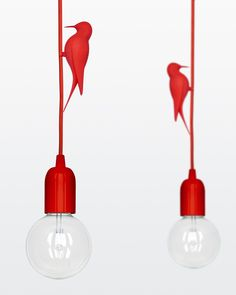 "Studio Macura have designed LETi, a pendant light that includes a clip-on printed bird. ""LETi, is a monochrome pendant light with a clipped printed bird around its textile covered"