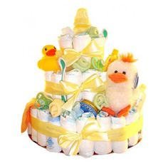 Ducky Diaper Cake - 53 Pampers diapers (Sesame Street Elmo print) Baby washcloths Johnson's baby wash, baby shampoo, baby powder and lotion An adorable stuffed ducky 6 pairs of baby socks (designed to look like flowers on the cake) 2 pacifiers A rubber ducky Baby spoons Baby bib Baby bottle - available at Gift With A Basket