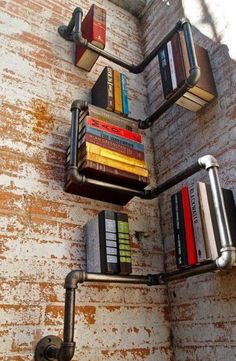 Inventive book shelving system using attached scaffolding style pipes! Create a similar shelf design using our Urban range http://www.morplan.com/shop/en/morplan/urban-retail-display-systems
