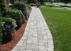 I like this idea for a pathway between the driveway and the front porch.  And maybe the driveway to the walkway.