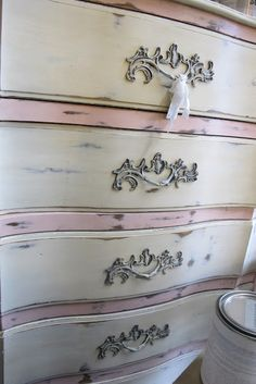 Dresser painted in Annie Sloan Chalk Paint. I mixed Emperor's Silk with Old White to get the pink. Drawers are Old White.