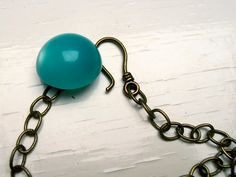 use a hook with a large button for a necklace closure - great idea from Songbeads!!