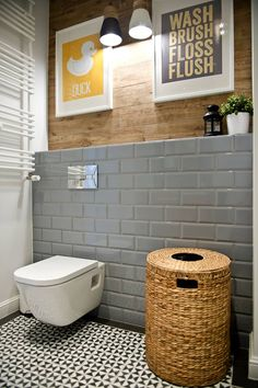 Grey Subway Tiled and Wood Bathroom. More