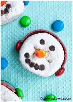 Learn to make these cute and easy snowman donuts, wearing ear muffs. Fun Winter craft to do with kids and you only need store-bought supplies!
