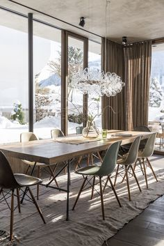 The chairs are by Vitra and the bespoke glass chandelier above the dining table is also by Isabel Hamm.