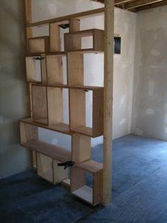 DIY wall of shelves. Easy and can create a three dimensional space for decorations or storage! Good room divider.