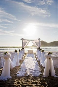 beach ceremony setup, I love this. I want more neutral colors within the white.