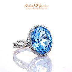 Oval Blue Topaz Halo Ring in 14K White Gold with Diamonds
