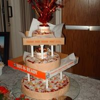 This cake was done as a joke for my cousin and his bride.  They met while they were both working at Little Ceasers.  You can eat the entire thing, except for the boxes and cups.