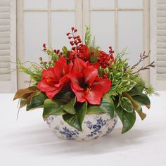 Show your guests that you know how to decorate with a classic holiday Amaryllis centerpiece arrangement. Christmas Flower Decorations, Christmas Flower Arrangements, Artificial Floral Arrangements, Christmas Flowers, Silk Flower Arrangements, Christmas Centerpieces, Flower Centerpieces, Ikebana, Faux Flowers