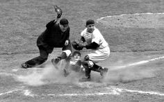 6 Oct. 1950, Yogi Berra tags Phillies shortstop Granny Hamner out at the plate. World Series, game 3, 9th inning, Yankee Stadium. Umpire Dusty Boggess.
