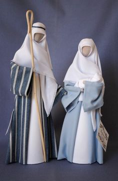 N4: Joseph with denim multi-striped gown and Mary with light blue gown.