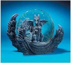 Redefining the role of the traditional snow globe, Manke the Dragon, extends a claw to protect against any trespasser hoping to catch a glimpse of the holiday riches stashed within your castle. Cast in designer resin, our unique work of dragon art is a highly collectible gift perfect for dragon lovers and snow globe connoisseurs alike.