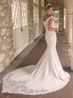 Looking to show off your shoulders and collarbones? This sophisticated crepe sheath bridal dress features an off-the-shoulder neckline and lacy straps to help you do just that. Off White Wedding Dresses, Crepe Wedding Dress, Maggie Sottero Wedding Dresses, Wedding Dress Pictures, Wedding Dress Train, Bridal Dresses, Lace Wedding, Chic Wedding, Prom Dresses