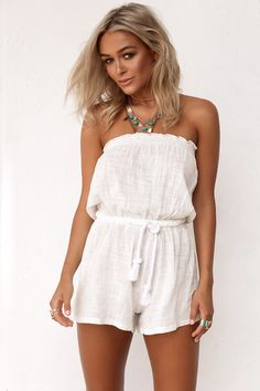 The Raw Layne Playsuit is a must-have summer staple! Made from a raw, off-white fabric, it features an elasticated bust and waistband, rope drawstring at waist and designed as a relaxed fit. Pair with gold arm cuffs and our Black Fedora for that perfect beachy look!