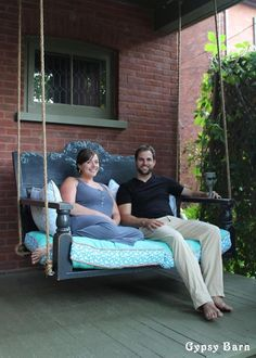 DIY porch swing made from a vintage headboard and an old wooden door.