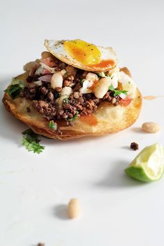 Mole Chili Cumin Beef Tostadas with Refried Cannellini Beans, Sour Cream Cabbage Slaw, Quail Eggs and Hot Sauce