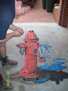 Fixing a Hydrant.  He must be turning it the wrong way...lol :)