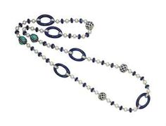 THE PROPERTY OF MADAME HÉLÈNE ROCHAS - A CULTURED PEARL, LAPIS LAZULI AND SAPPHIRE NECKLACE The chain composed of cultured pearls alternating with fluted lapis-lazuli beads and rock crystal faceted rondelles, enhanced by three pavé-set sapphire and diamond bead links, two pavé-set sapphire elements decorated with turquoise cabochons and five lapis-lazuli oval-shaped rings, can be detached and worn as two shorter necklaces.