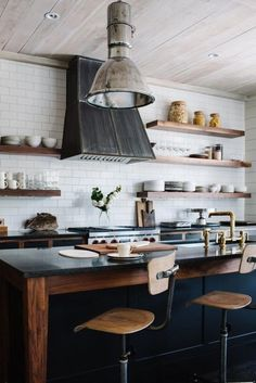 Rustic industrial kitchen with open shelving.