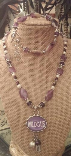 Sharing my personal fan/school spirit set.  KANSAS STATE UNIVERSITY WILDCATS of course... Egyptian AAA grade Amethyst 8mm beads, mixed with rustic tumbled genuine Amethyst in squares and pointed ovals, Freshwater cultured pearls,  Antiqued Silver plate caps, accents, and toggle closure. Bubble pendant reversible to a power purple and white chevron design. Set would retail at $59 for the necklace and $39 for the bracelet. To order CALL 620-340-2749 or EMAIL: michielle@live.com