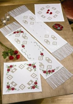 Hardanger Table Mats with Red Roses - hardanger kit by Permin of Copenhagen - Lovely table mats with openwork areas and sprays of roses. Hardanger Embroidery, Embroidery Patterns, Hand Embroidery, Flower Mobile, Drawn Thread, Beaded Cross Stitch, Bargello, Table Runners, Red Roses