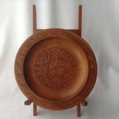 Hand carved wooden plate and stand by HouseOfHalo on Etsy, $24.95
