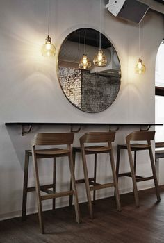Stylish bar seating area designed by Joanna Laajisto in bar & restaurant Intro, in Kuopio, Finland. The bar stools, lamps and the mirror talk to each other nicely. Cafe Design, Interior Design, Design Design, Design Ideas, Painted Bar Stools, Black Bar Stools, Patio Bar Set, Kitchen Stools, Counter Stools