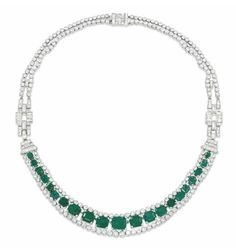 An Art Deco emerald and diamond necklace, by Cartier. Sold for USD 272.323