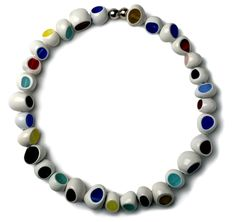 Elisabeth Leenknegt - Necklace COCO. Elisabeth makes jewelry of hand forged silver and blown glass. These are characterized by a playful design and a great coloring. Humor is the central key in her work.