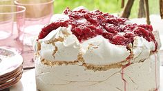 Sky-high meringue is teamed with billows of freshly whipped cream and homemade rhubarb compote for this showstopping cake.
