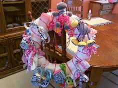 zebra theme DIAPER WREATH for a girl.  Everything on here is zebra print.  This also went with a matching diaper cake.