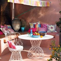 I love these kicky vintage wire outdoor furniture pieces, lace-y and crocheted and so fun... plus love the adobe moroccan vibe