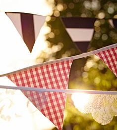 Wedding Day Decor - String up DIY fabric flags to make your wedding celebration feel like a day at the fair.
