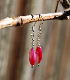 Handmade hot pink shell earrings with sterling silver beads. Pink shell and silver graduated size bead earrings. Fuschia shell earrings (16.00 USD) by KarmaKittyJewelry