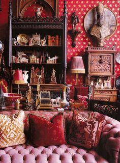 Living room, lots of fascinating antiques/collectibles, oddities, tufted couch, fringed lamp via: Divinely Decadent