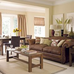 The type of leather sofa i want for family room like the curtains to be yellow or cream
