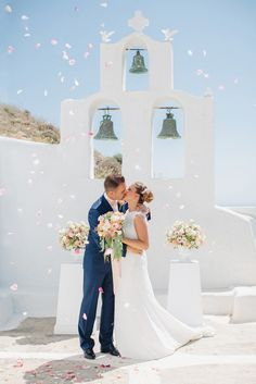 ceremony petal toss - photo by Julia Kaptelova http://ruffledblog.com/romantic-santorini-elopement