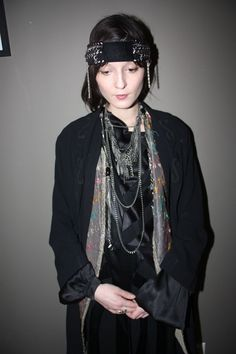 """""""I was born in Romania and left at four years old. We were political refugees, which is why we had to leave. I grew up in Canada and London. I'm all over the place."""" <P> Chanel necklace and hat; vintage '30s coat, vintage dress and waistcoast"""