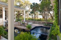 A step down from the breezeway, a spa and lap pool overlook the Colleton River, by Historical Concepts